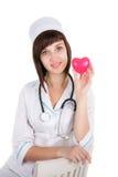 Docteur féminin avec le coeur Photos stock