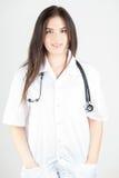 Docteur féminin heureux avec le stéthoscope photographie stock