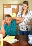 Docteur Office et infirmière Photographie stock libre de droits