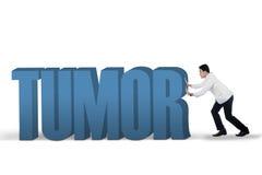 Docteur poussant un texte de tumeur images libres de droits