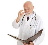 Docteur - sérieux au sujet de votre santé Photographie stock libre de droits