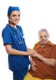 Docteur tenant la main de patients photographie stock libre de droits