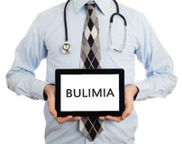 Docteur tenant le comprimé - boulimie photographie stock libre de droits
