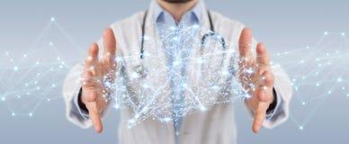 Docteur tenant le rendu numérique de l'interface 3D de cerveau Photo stock