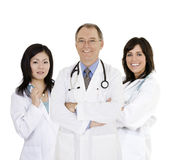 Group of confident doctors and nurses with their arms crossed displaying some attitude Stock Photos