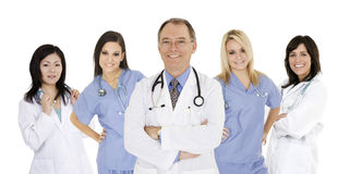 Group of confident doctors and nurses with their arms crossed displaying some attitude isolated on white background Stock Photo