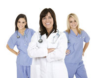Group of confident doctors and nurses with their arms crossed displaying some attitude Stock Image