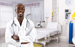 Doctor. Portrait of happy young african doctor in hospital ward Stock Images