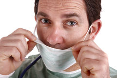 Doctor. A portrait of doctor (mature man on forties) using a mask Stock Images