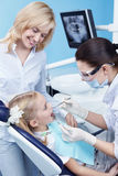 At the doctor. Child treated teeth in the dental clinic Royalty Free Stock Image