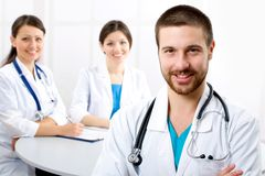Doctor. The young male doctor and its colleagues Royalty Free Stock Images