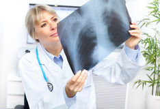 Doctor. Medical doctor looking at a x-ray image in the office Stock Image