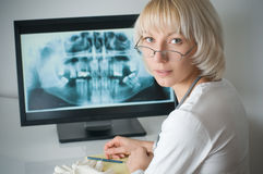 Doctor. Looking at x-ray on computer royalty free stock photography