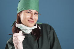 Doctor. Female doctor with tweezers in her hand Stock Photos