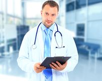 Doctor. Frontal portrait of doctor in white coat and stethoscope with arms crossed Stock Photos