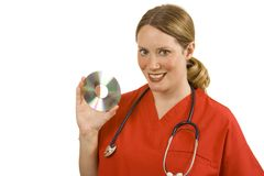 Doctor. Female doctor in orange scrubs holding a cd Stock Image