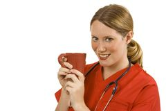 Doctor. Female doctor in orange scrubs holding a cup of coffee Royalty Free Stock Photography
