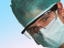 The doctor. Doctor portrait with mask and glasses Royalty Free Stock Photography