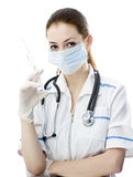 Doctor. Holding a syringe in his hand royalty free stock images