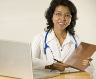 Doctor. Smiling and confident female Asian Doctor sitting down Stock Photography