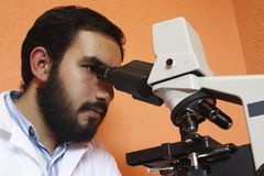 Doctor. With a modern microscope in a laboratory. Mexico Stock Photography