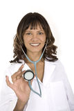 Female African American doctor or nurse wearing a lab coat. With a stethoscope isolated on a white background Stock Images