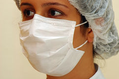 Doctor. A Nurse or Doctor using a mask royalty free stock images