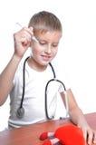 Doctor 7 años del muchacho Imagen de archivo libre de regalías