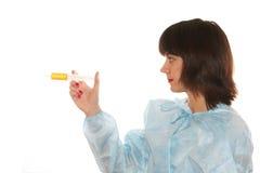 Doctor. Holding a syringe  on white background Royalty Free Stock Images