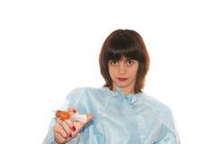 Doctor. Holding a syringe  on white background Stock Images