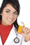 Caucasian doctor or Nurse holding a bottle of pills Stock Photos
