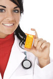 Caucasian doctor or Nurse holding a bottle of pills Stock Image