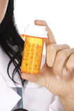 Caucasian doctor or Nurse holding a bottle of pills Royalty Free Stock Image