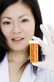 Asian doctor or Nurse holding a bottle of pills Stock Photo