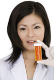 Asian doctor or Nurse holding a bottle of pills Stock Image