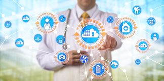 Doctor Accessing Data Via Cloud Containers App. Unrecognizable male physician accessing electronic medical records via a network based on cloud container royalty free stock photography