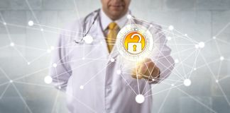 Doctor Accessing Data Via Secure Network. Unrecognizable male doctor of medicine accessing medical records via a secure communication network. Information stock images