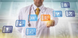 Doctor Accessing Medical Records Via Blockchain. Unrecognizable doctor accessing medical records by selecting a data block in a healthcare blockchain. Internet royalty free stock image