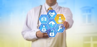 Doctor Activating Managed Health Care Services. Unrecognizable male doctor activating health services via touch screen. Medical IT concept for managed healthcare royalty free stock photography