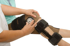 Doctor adjustable angle knee brace support. For leg or knee injury Stock Photo