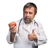 Doctor advises apple for healthy eating Royalty Free Stock Photo