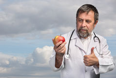 Doctor advises apple for healthy eating Royalty Free Stock Image