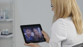Doctor advises a married couple. medical on-line consultations. 4K
