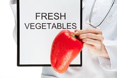 Doctor advising eating fresh vegetables Stock Photo