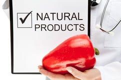 Doctor advising eating natural food Royalty Free Stock Photos