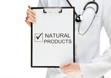 Doctor advising eating natural products Stock Photos