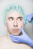 Doctor aesthetician makes face beauty injections to male patient Royalty Free Stock Photos