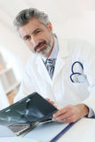Doctor analysing patient's x-ray results Stock Image