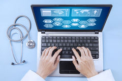 Doctor analyzing human illness on laptop Royalty Free Stock Image