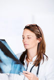 Doctor Analyzing Xray In Clinic Royalty Free Stock Photography